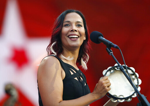 "FILE - In this Tuesday, July 3, 2018, file photo, Rhiannon Giddens performs during rehearsal for the Boston Pops Fireworks Spectacular in Boston. Giddens' new album, ""They're Calling Me Home,"" releases on Friday. (AP Photo/Michael Dwyer, File)"