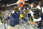 North Carolina A&T coach Sam Washington is doused by defensive back Jalon Bethea during the final seconds of the Celebration Bowl NCAA college football game against Alcorn State, Saturday, Dec. 21, 2019, in Atlanta. North Carolina A&T won 64-44. (John Amis/Atlanta Journal-Constitution via AP)