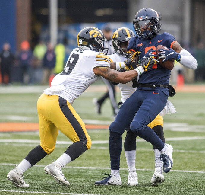 Illinois's Sam Mays (9) is tackled by Iowa's Geno Stone (9) after making a reception in the first half of a NCAA college football game Saturday, Nov. 17, 2018, in Champaign, Ill. (AP Photo/Holly Hart)