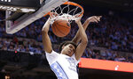 FILE - In this Dec. 15, 2018, file photo, North Carolina's Cameron Johnson (13) dunks against Gonzaga during the first half of an NCAA college basketball game, in Chapel Hill, N.C. Johnson was named to the AP All-ACC team, Tuesday, March 12, 2019.(AP Photo/Gerry Broome, File)