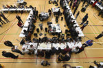 Ballot papers cast in the 2019 general election are counted in Islington in London, Thursday, Dec. 12, 2019. An exit poll in Britain's election projects that Prime Minister Boris Johnson's Conservative Party likely will win a majority of seats in Parliament. That outcome would allow Johnson to fulfil his plan to take the U.K. out of the European Union next month. (AP Photo/Alberto Pezzali)