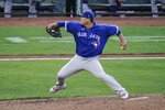 Toronto Blue Jays starting pitcher Hyun Jin Ryu throws a pitch to the Baltimore Orioles during the third inning of the first game of a baseball doubleheader, Saturday, Sept. 11, 2021, in Baltimore. (AP Photo/Julio Cortez)