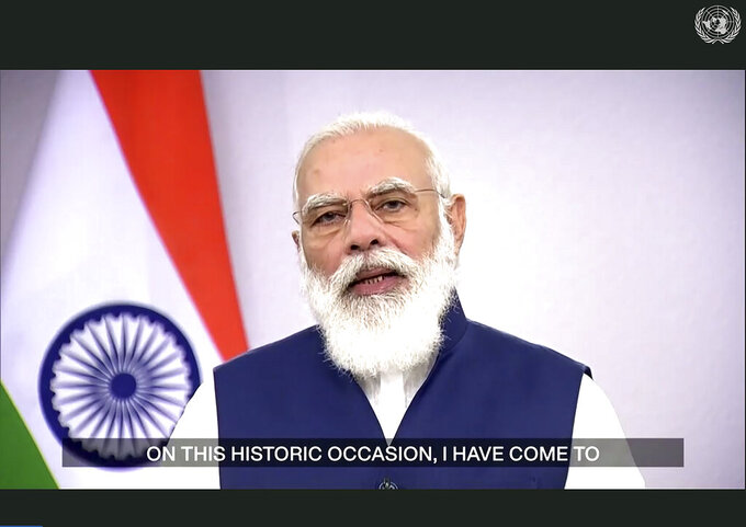 In this photo made from UNTV video, Narendra Modi, Prime Minister of India, speaks in a pre-recorded message which was played during the 75th session of the United Nations General Assembly, Saturday, Sept. 26, 2020, at UN Headquarters. (UNTV Via AP )