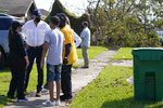 President Joe Biden talks as he tours a neighborhood impacted by Hurricane Ida, Friday, Sept. 3, 2021, in LaPlace, La. (AP Photo/Evan Vucci)