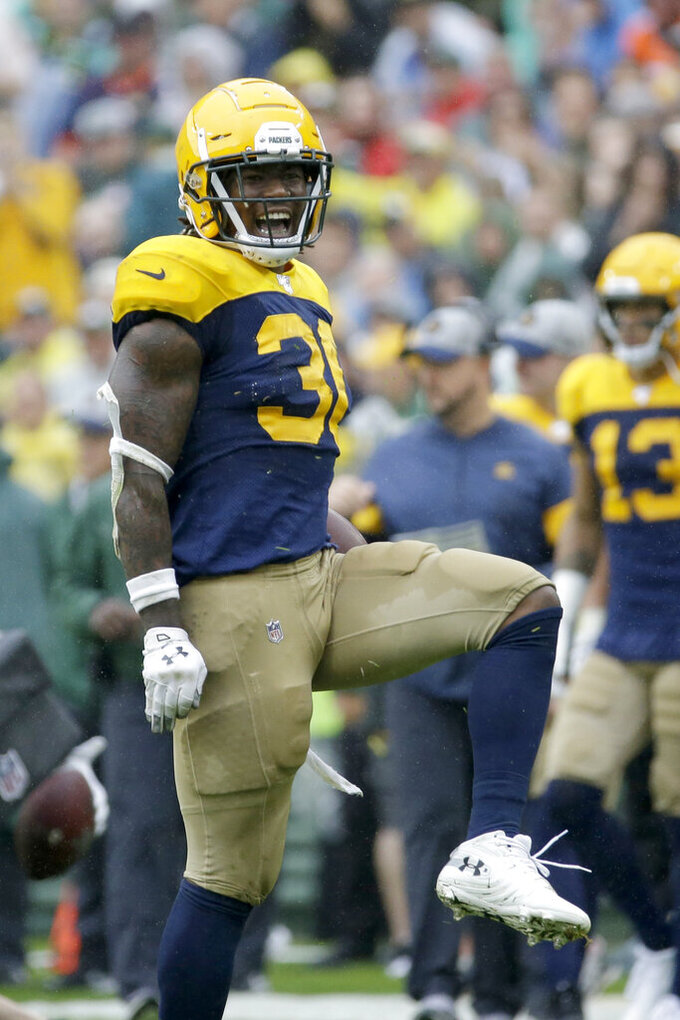 Green Bay Packers running back Jamaal Williams celebrates running for a first down during the second half of an NFL football game against the Denver Broncos, Sunday, Sept. 22, 2019, in Green Bay, Wis. (AP Photo/Mike Roemer)