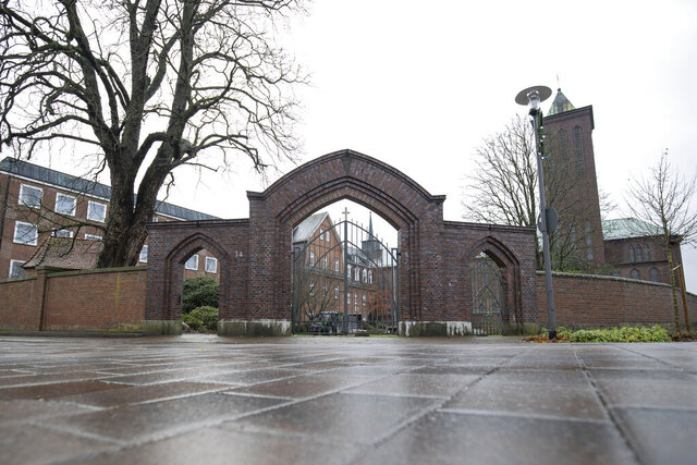 Exterior view of the monastery of the Franciscan Order in Thuine, Germany, Tuesday, Dec.1, 2020. Church authorities say 76 Catholic nuns have tested positive for COVID-19 after an outbreak of coronavirus at a Franciscan convent in northwestern Germany. Another 85 nuns received negative test results at the monastery in Thuine, not far from the Dutch border, the convent's Mother Superior told The Associated Press on Tuesday. (Friso Gentsch/dpa via AP)