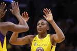 """FILE - In this Friday, May 31, 2019, file photo, Los Angeles Sparks' Chiney Ogwumike (13), obscured at left, and her sister Nneka Ogwumike celebrate after a win over the Connecticut Sun in a WNBA basketball game in Los Angeles. The WNBA and its union announced a tentative eight-year labor deal Tuesday, Jan. 14, 2020,  that will allow top players to earn more than $500,000 while the average annual compensation for players will surpass six figures for the first time. """"It was collaborative effort,'"""
