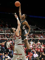 Washington State forward Marvin Cannon, top, shoots against Stanford center Josh Sharma during the first half of an NCAA college basketball game in Stanford, Calif., Thursday, Feb. 28, 2019. (AP Photo/Jeff Chiu)