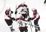 Colorado Avalanche players celebrate a goal against the Dallas Stars during the first period of an NHL hockey playoff game Wednesday, Aug. 5, 2020 in Edmonton, Alberta. (Jason Franson/The Canadian Press via AP)