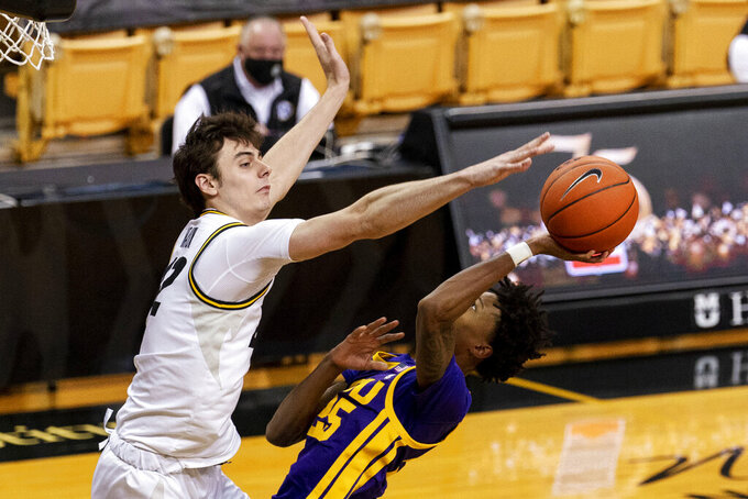 Missouri's Parker Braun, left, tries to block the shot of LSU's Eric Gaines, right, during the first half of an NCAA college basketball game Saturday, March 6, 2021, in Columbia, Mo. (AP Photo/L.G. Patterson)