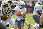 Citadel quarterback Brandon Rainey (16) runs out of the pocket against The Citadel during the first half of an NCAA college football game, Saturday, Sept. 14, 2019, in Atlanta. (AP Photo/Mike Stewart)