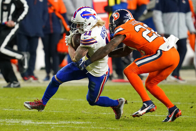 Buffalo Bills wide receiver Cole Beasley runs with the ball as Denver Broncos safety Kareem Jackson defends during the second half of an NFL football game Saturday, Dec. 19, 2020, in Denver. (AP Photo/David Zalubowski)