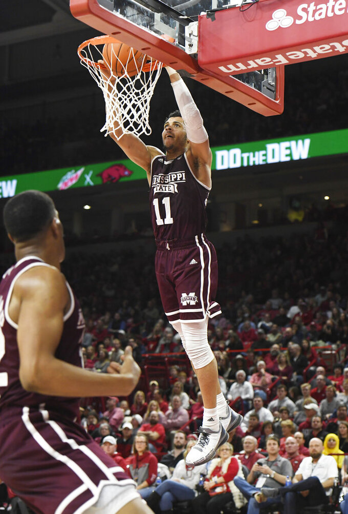 Mississippi State guard Quinndary Weatherspoon (11) dunks against Arkansas during the second half of an NCAA college basketball game Saturday, Feb. 16, 2019, in Fayetteville, Ark. (AP Photo/Michael Woods)