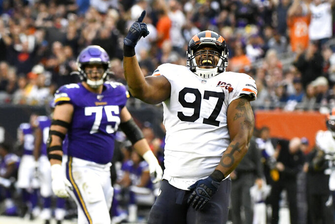 Chicago Bears defensive tackle Nick Williams (97) celebrates after sacking Minnesota Vikings quarterback Kirk Cousins as Vikings' Brian O'Neill (75) watches during the second half of an NFL football game Sunday, Sept. 29, 2019, in Chicago. (AP Photo/Matt Marton)
