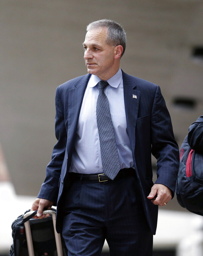 FILE - In this July 2, 2013, file photo, former FBI Director Louis Freeh leaves Federal Court in New Orleans. The NCAA unveiled a new arm of rules enforcement made up of independent investigators, advocates and decision-makers to handle what it calls complex cases involving serious infractions. The Independent Accountability Resolution Process will be comprised of four groups, including the Complex Case Unit, which will conduct investigations and provide representation for schools and individuals accused of violations. Among those chosen for the CCU were former FBI Director Louis Freeh. (AP Photo/Gerald Herbert, File)