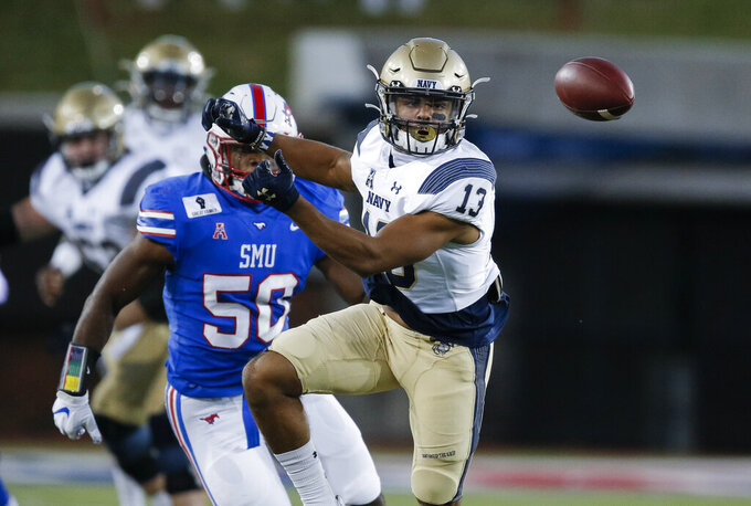 Navy running back Chance Warren (13) is unable to catch a pass as SMU linebacker Richard McBryde (50) defends during the first half of NCAA college football game Saturday, Oct. 31, 2020, in Dallas. (AP Photo/Brandon Wade)