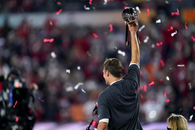 Tampa Bay Buccaneers quarterback Tom Brady celebrates after the NFL Super Bowl 55 football game against the Kansas City Chiefs, Sunday, Feb. 7, 2021, in Tampa, Fla. The Buccaneers defeated the Chiefs 31-9 to win the Super Bowl. (AP Photo/Mark Humphrey)