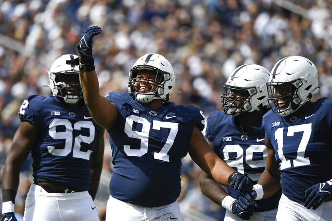 Penn State defensive tackle PJ Mustipher (97) celebrates after sacking Villanova quarterback Daniel Smith in the second quarter during an NCAA college football game in State College, Pa., on Saturday, Sept. 25, 2021. (AP Photo/Barry Reeger)