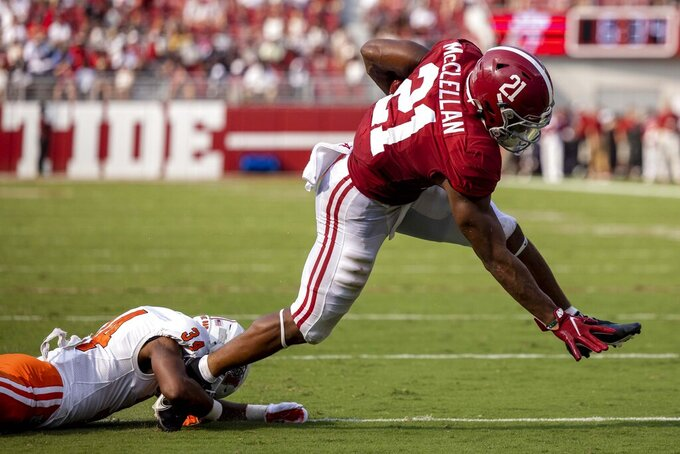 Alabama running back Jase McClellan (21) breaks free from Mercer defensive back Myles Redding (34) for a touchdown during the first half of an NCAA college football game, Saturday, Sept. 11, 2021, in Tuscaloosa, Ala. (AP Photo/Vasha Hunt)