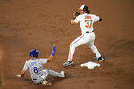 Baltimore Orioles second baseman Jahmai Jones (37) turns a double play as Kansas City Royals' Nicky Lopez (8) tries to break it up on a ball hit by Salvador Perez during the third inning of a baseball game, Thursday, Sept. 9, 2021, in Baltimore. (AP Photo/Julio Cortez)