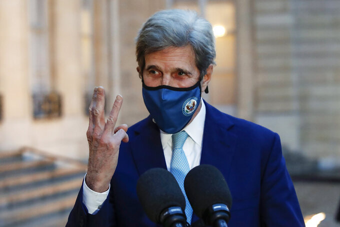 FILE - In this March 10, 2021, file photo, United States Special Presidential Envoy for Climate John Kerry gestures as he speaks to the media after a meeting with French President Emmanuel Macron at the Elysee Palace in Paris. Kerry is in talks in China on Thursday, April 15, 2021 ahead of President Joe Biden's climate summit of world leaders. (AP Photo/Michel Euler, File)