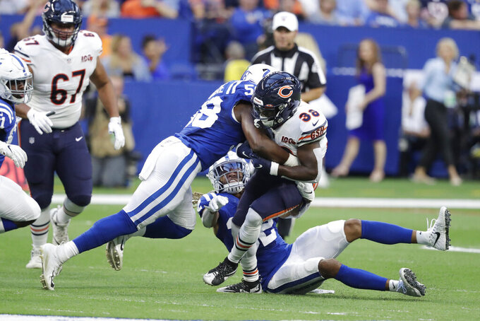 Chicago Bears running back Kerrith Whyte (38) is tackled by Indianapolis Colts inside linebacker Bobby Okereke (58) during the first half of an NFL preseason football game Saturday, Aug. 24, 2019, in Indianapolis. (AP Photo/Michael Conroy)