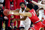 Maryland forward Donta Scott, left, is defended by Ohio State forward Justice Sueing during the first half of an NCAA college basketball game, Monday, Feb. 8, 2021, in College Park, Md. (AP Photo/Julio Cortez)