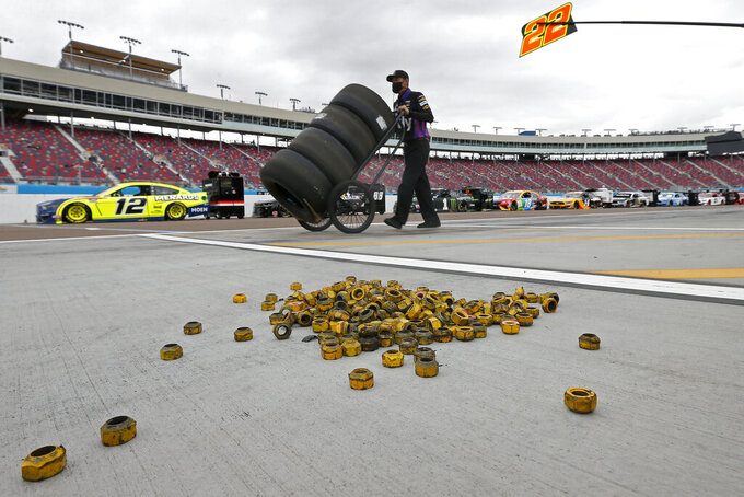 Lug nuts sit on pit road prior to a NASCAR Cup Series auto race at Phoenix Raceway, Sunday, Nov. 8, 2020, in Avondale, Ariz. (AP Photo/Ralph Freso)