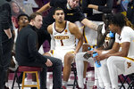 Minnesota head coach Richard Pitino, left, holds a conference with his team during a timeout in the first half of an NCAA college basketball game against Rutgers, Saturday, March 6, 2021, in Minneapolis. (AP Photo/Jim Mone)