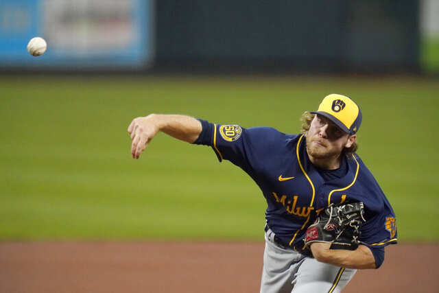 Milwaukee Brewers starting pitcher Corbin Burnes throws during the first inning of a baseball game against the St. Louis Cardinals Thursday, Sept. 24, 2020, in St. Louis. (AP Photo/Jeff Roberson)