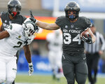 Air Force fullback Cole Fagan, right, runs for a long gain past Colorado State cornerback Dajon Owens in the first half of an NCAA college football game Thursday, Nov. 22, 2018, at Air Force Academy, Colo. (AP Photo/David Zalubowski)