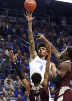 Kentucky's Nick Richards (4) shoots while defended by Eastern Kentucky's Houston King (14) and Darius Hicks during the first half of an NCAA college basketball game in Lexington, Ky., Friday, Nov. 8, 2019. (AP Photo/James Crisp)