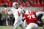 Ohio State quarterback Justin Fields (1) throws a pass as Nebraska defensive lineman Darrion Daniels (79) defends during the first half of an NCAA college football game in Lincoln, Neb., Saturday, Sept. 28, 2019. (AP Photo/Nati Harnik)