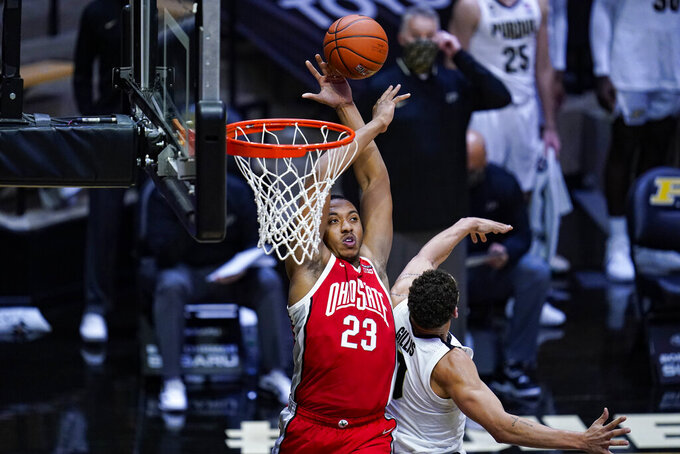 Ohio State center Zed Key (23) gos up for a shot over Purdue forward Mason Gillis (0) during the first half of an NCAA college basketball game in West Lafayette, Ind., Wednesday, Dec. 16, 2020. (AP Photo/Michael Conroy)