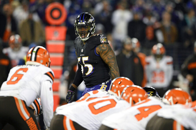 FILE - In this Sunday, Dec. 30, 2018 file photo,Baltimore Ravens outside linebacker Terrell Suggs (55) looks across the line of scrimmage in the second half of an NFL football game against the Cleveland Browns in Baltimore. Defense is the area with the most depth in this year's free agency class, Monday, March 11, 2019. (AP Photo/Nick Wass, File)