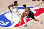 Utah Jazz's Donovan Mitchell (45) defends as Denver Nuggets' Jamal Murray (27) advances the ball down court during the second half an NBA first round playoff basketball game, Tuesday, Sept. 1,2020, in Lake Buena Vista, Fla. (AP Photo/Mark J. Terrill)