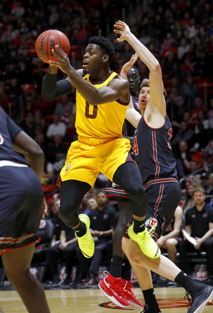 Arizona State's Luguentz Dort (0) looks to pass the ball as Utah's Jayce Johnson, right, defends during the first half of an NCAA college basketball game Saturday, Feb. 16, 2019, in Salt Lake City. (AP Photo/Kim Raff)
