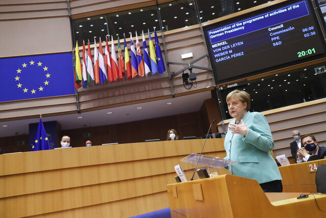 German Chancellor Angela Merkel addresses a plenary session at the European Parliament in Brussels, Wednesday, July 8, 2020. Germany has just taken over the European Union's rotating presidency, and must chaperone the 27-nation bloc through a period of deep crisis for the next six months and try to limit the economic damage inflicted by the coronavirus. (Yves Herman, Pool Photo via AP)