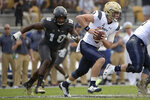 FILE - In this Nov. 10, 2018, file photo, Navy quarterback Zach Abey (9) rushes for yardage in front of Central Florida defensive lineman Titus Davis (10) during the first half of an NCAA college football game in Orlando, Fla. Navy faces Tulsa on Saturday. (AP Photo/Phelan M. Ebenhack, File)