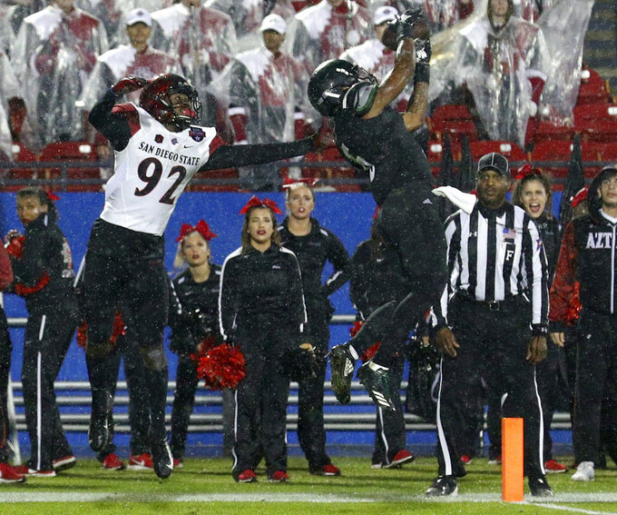 Ohio safety De'Vante Mitchell (6) breaks up a pass intended for San Diego State wide receiver Kobe Smith (92) during the Frisco Bowl NCAA college football game, Wednesday, Dec. 19, 2018, in Frisco, Texas. (AP Photo/Richard W. Rodriguez)