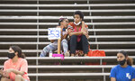 Fans keep social distance from each other as East Jefferson plays Newman in a high school football game in Metairie, La., during the coronavirus pandemic, Thursday, Oct. 1, 2020. (Chris Granger/The Times-Picayune/The New Orleans Advocate via AP)