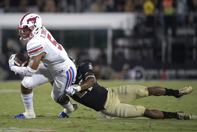 SMU running back Xavier Jones (5) is tackled by Central Florida defensive back Rashard Causey (21) after catching a pass during the first half of an NCAA college football game Saturday, Oct. 6, 2018, in Orlando, Fla. (AP Photo/Phelan M. Ebenhack)