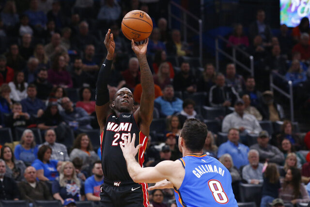 Miami Heat guard Kendrick Nunn (25) shoots over Oklahoma City Thunder forward Danilo Gallinari (8) in the first half of an NBA basketball game Friday, Jan. 17, 2020, in Oklahoma City. (AP Photo/Sue Ogrocki)