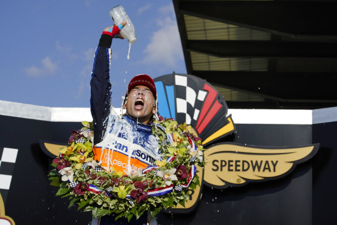 Takuma Sato, of Japan, celebrates after winning the Indianapolis 500 auto race at Indianapolis Motor Speedway, Sunday, Aug. 23, 2020, in Indianapolis. (AP Photo/Michael Conroy)