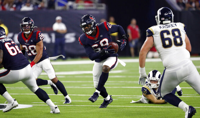 Houston Texans linebacker Jesse Aniebonam (69) returns an interception during the first half of a preseason NFL football game against the Los Angeles Rams Thursday, Aug. 29, 2019, in Houston. (AP Photo/Kevin M. Cox)