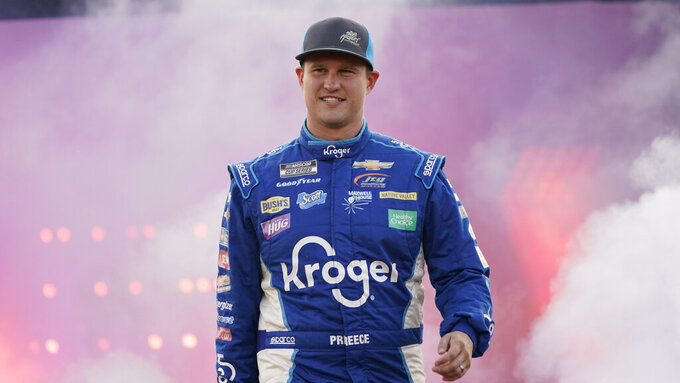 Ryan Preece waves to the crowd during driver introductions prior to the start of the NASCAR Cup series auto race in Richmond, Va., Saturday, Sept. 11, 2021. (AP Photo/Steve Helber)