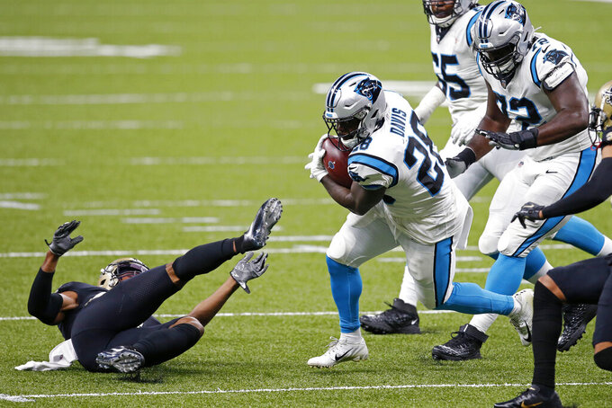 Carolina Panthers running back Mike Davis (28) carries against New Orleans Saints free safety Marcus Williams, on ground, in the first half of an NFL football game in New Orleans, Sunday, Oct. 25, 2020. (AP Photo/Butch Dill)