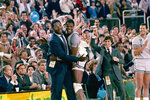 FILE - Georgetown head coach John Thompson, left, gives a happy pat to the most valuable player, Patrick Ewing, after Georgetown defeated Houston in the NCAA college basketball championship game in Seattle, in this April 2, 1984, file photo. Patrick Ewing and Georgetown are back in the NCAA Tournament. The 7-footer who helped the Hoyas win one national championship and reach two other finals in the 1980s is now coaching at his alma mater. Georgetown is a No. 12 seed and will play No. 5 Colorado in the East Region on Saturday, March 20, 2021. (AP Photo/File)