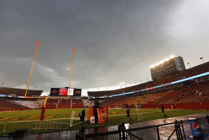 Storm clouds roll in over Jack Trice Stadium during a lightning delay in the first half of an NCAA college football game between Iowa State and Iowa, Saturday, Sept. 14, 2019, in Ames, Iowa. (AP Photo/Charlie Neibergall)