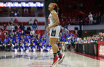 North Carolina State's Kai Crutchfield reacts following a basket against Kentucky during the second half of a second-round women's college basketball game in the NCAA Tournament in Raleigh, N.C., Monday, March 25, 2019. (AP Photo/Gerry Broome)